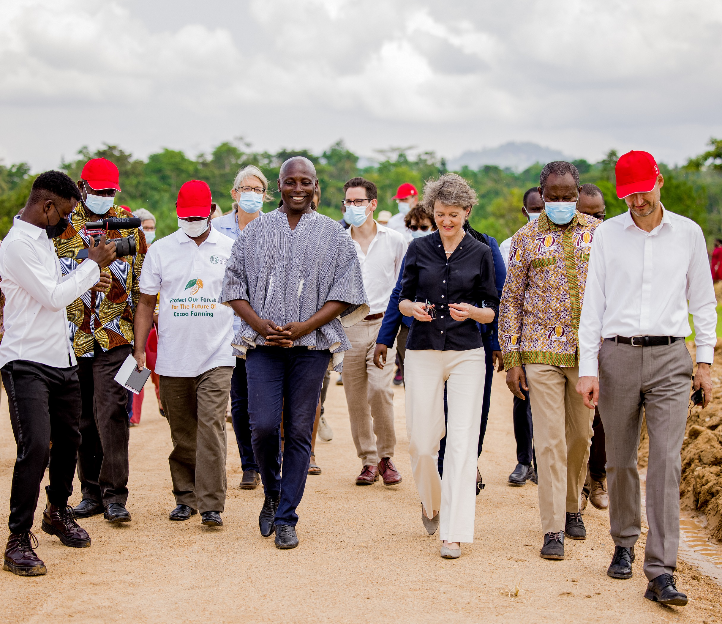 Yayrator Glover walks with Swiss Federal Councillor and her delegation
